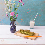 Martabak / Indonesian Sweet Giant Pancake, green tea flavour with cheddar cheese. Served with milk. On vintage background Royalty Free Stock Photos