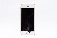 Martele e um smartphone com uma tela quebrada Foto de Stock Royalty Free