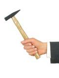 Martello della holding della mano dell'uomo d'affari Fotografia Stock