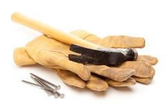 Martello, guanti e chiodi fotografia stock