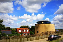 Martello Tower Dymchurch Kent England. Beautiful view from Dymchurch village with with Martello Tower number 23 on nice summer day,Kent England United Kingdom Royalty Free Stock Photography