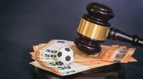 Martelo da lei, bola de futebol e euro no fundo preto fotos de stock