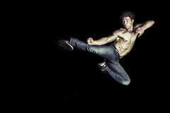 Martial art athlete doing the kick jumping Royalty Free Stock Photos