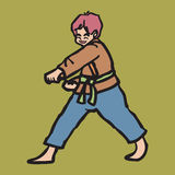 Martial art boy punching Royalty Free Stock Images