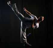 Martial art high kick. Man in dark practice martial art - high kick Stock Photography