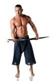 Martial art man: muscular man with kimono trousers and sword Royalty Free Stock Photography