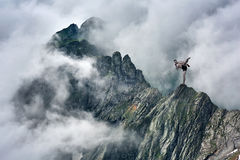 Martial artist training in mountains Stock Photo