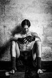 Martial Artist. Young adult martial artist in front of a concrete block wall. Black and white Royalty Free Stock Photos