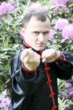 Martial arts. Man doing martial arts outdoors Royalty Free Stock Photography
