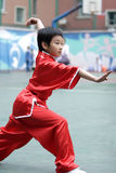 Martial arts. The little girl in the match of gongfu Royalty Free Stock Photos