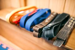 Martial arts, brown, orange, blue and black belts Royalty Free Stock Images