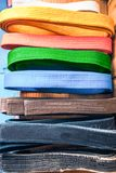 Martial arts, brown, orange, blue and black belts Stock Photography