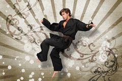 Martial arts expert jumping Stock Photography