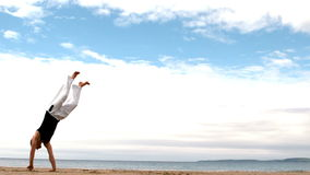 Martial arts expert practicing on the beach stock footage