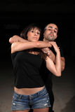 Martial arts female instructor. Exercising with young man stock photo