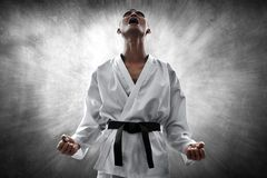 Martial arts fighter angry and screaming stock image