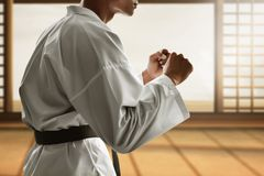 Martial art fighter in dojo royalty free stock photography