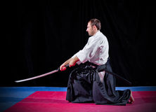 Martial arts fighter with katana Royalty Free Stock Photography