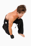 Martial arts fighter kneeling down Stock Photos