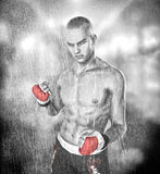 Martial arts fighter man. MMA / UFC martial arts street fighter / boxer, man in the rain Royalty Free Stock Photo