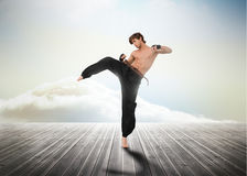 Martial arts fighter over wooden boards Royalty Free Stock Photos