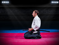 Martial arts fighter with sword Royalty Free Stock Photos