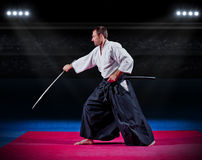 Martial arts fighter with sword. At sports hall Royalty Free Stock Photography