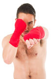 Martial arts fighter wearing red shorts and Royalty Free Stock Images