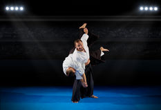 Martial arts fighters. In sports hall Royalty Free Stock Image