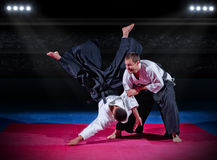 Martial arts fighters at sports hall Stock Photos