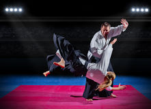 Martial arts fighters at sports hall royalty free stock photography