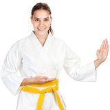 Martial arts girl. Isolated on white background Stock Image