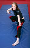 Martial arts girl with sai Stock Photography