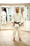 Martial arts instructor. Posing in a guard stance Stock Photography