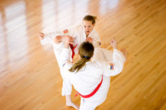 Martial arts kicking. Royalty Free Stock Images