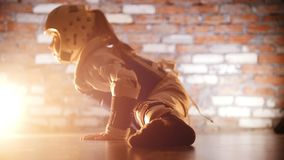 Martial arts. Little girl training her karate skills. Showing the split and her stretching. Side view stock footage