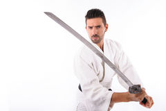 Martial arts man with sword Stock Photo
