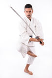 Martial arts man with sword Stock Images