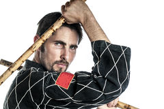 Martial arts master with bamboo sticks Stock Photography