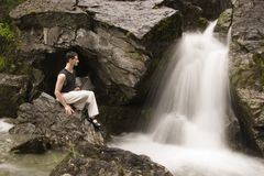 Martial arts - meditation next to waterfall Royalty Free Stock Photos