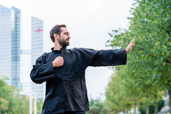 Martial arts sportsman practicing karate in city Stock Photo