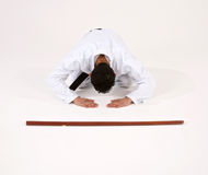 Martial Arts student bowing. In attitude of surrender or subservience royalty free stock photos