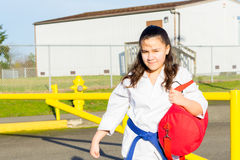 Martial Arts Student Gets Ride to Practice Stock Photo