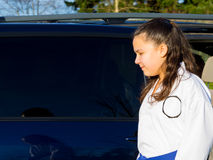 Martial Arts Student Gets Ride to Practice Royalty Free Stock Image