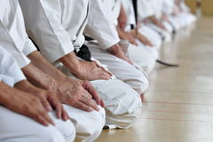 Martial arts students. Sitting on their heels in the traditional seiza style stock photos