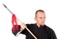 Martial arts teacher with spear in defensive pose Royalty Free Stock Images