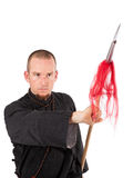 Martial arts teacher with spear in fighting pose Royalty Free Stock Photography