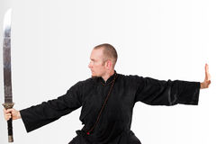 Martial arts teacher with sword up Stock Photo