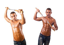 The martial arts warrior with nunchucks on white Royalty Free Stock Photos