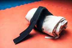 Martial arts, white kimono and black belt closeup Royalty Free Stock Images